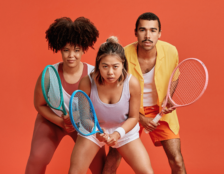 Three social tennis players in a ready positon